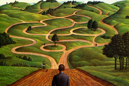 Man Standing At Beginning Of Winding Road